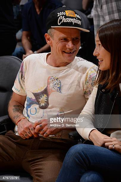 Recording artist Flea of the Red Hot Chili Peppers looks on during a game between the San Antonio Spurs and the Los Angeles Lakers at Staples Center...