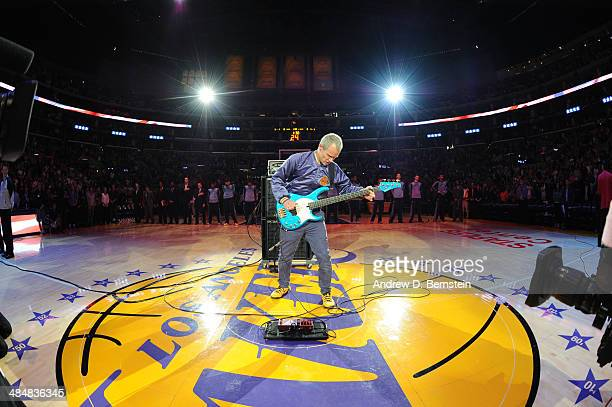 Recording artist Flea of the Red Hot Chili Peppers performs the National Anthem before a game between the Memphis Grizzlies and the Los Angeles...