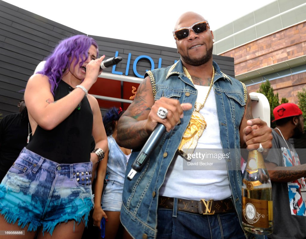 Recording artist Flo Rida (R) and singer Stayc Reign perform at the Liquid Pool Lounge at the Aria Resort & Casino at CityCenter on May 27, 2013 in Las Vegas, Nevada.