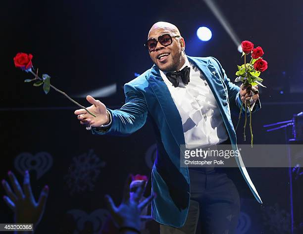 Recording artist Flo Rida performs onstage during 106.1 KISS FM's Jingle Ball 2013 at American Airlines Center on December 2, 2013 in Dallas, Texas.