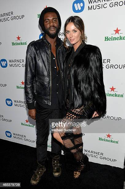 Recording artist Gary Clark Jr and model Nicole Trunfio attend the Warner Music Group annual GRAMMY celebration on January 26 2014 in Los Angeles...