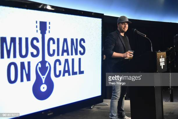 Recording artist Gavin DeGraw speaks onstage as Musicians On Call hosts A Night To Celebrate the Healing Power of Music at Madison Square Garden on...