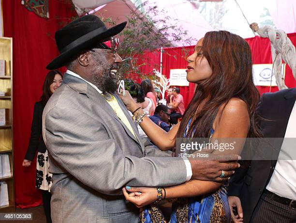 Recording artist George Clinton and Bobbi Kristina Brown attend the GRAMMY Gift Lounge during the 56th Grammy Awards at Staples Center on January 25,...