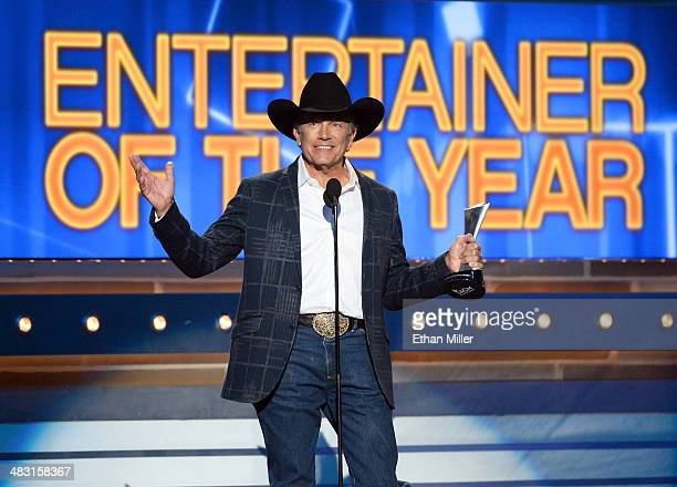 Recording artist George Strait accepts the Entertainer of the Year award onstage during the 49th Annual Academy of Country Music Awards at the MGM...