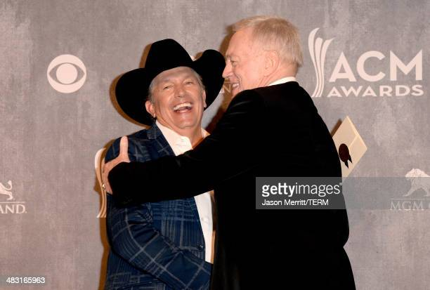 Recording artist George Strait winner of the Entertainer of the Year award and Owner President and General Manager of the Dallas Cowboys Jerry Jones...