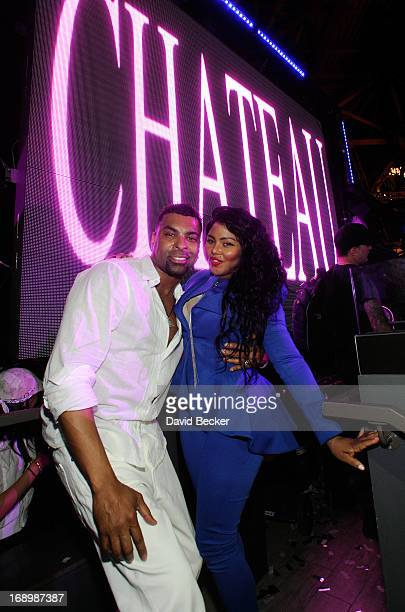 Recording artist Ginuwine and Lil' Kim appear at the Chateau Nightclub Gardens at the Paris Las Vegas on May 17 2013 in Las Vegas Nevada
