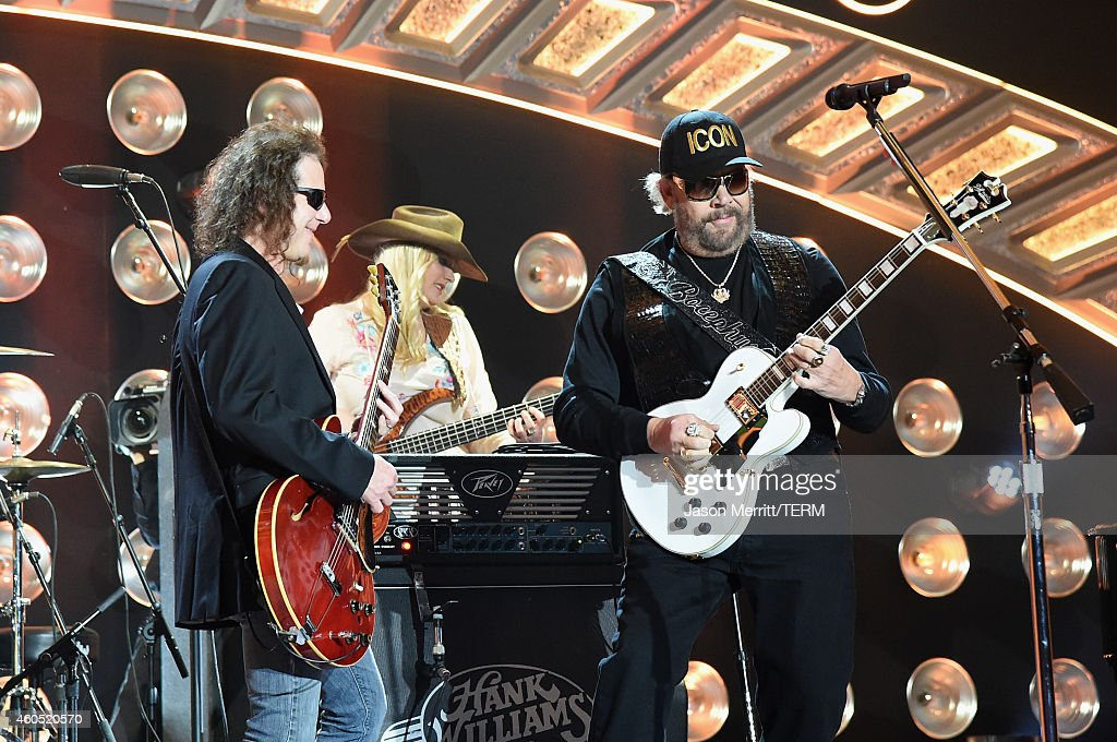 Recording artist Hank Williams, Jr. (R) performs onstage during the 2014 American Country Countdown Awards at Music City Center on December 15, 2014 in Nashville, Tennessee.