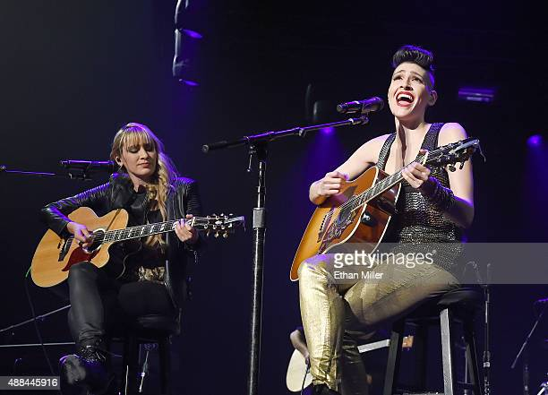 Recording artist Hanna Nicole Perez Mosa and Ashley Grace Perez Mosa of Ha*Ash perform as the pop duo opens for Ricky Martin during the kickoff of...