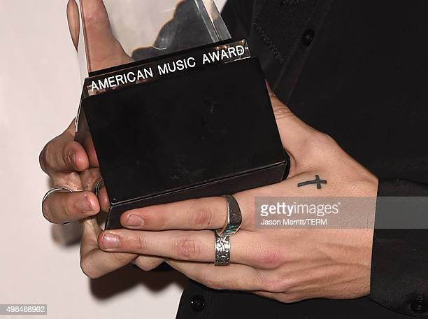 Recording artist Harry Styles of One Direction winner of Favorite Pop/Rock Band/Duo/Group poses in the press room during the 2015 American Music...