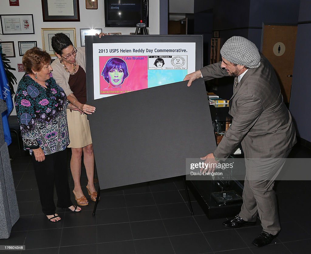 Recording artist Helen Reddy, West Hollywood Mayor Mayor Abbe Land and pop artist Nicolosi attend the unveiling of the new United States Postal Service special pictorial postmark featuring Helen Reddy on August 19, 2013 in West Hollywood, California.