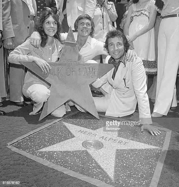 Recording artist Herb Alpert is joined by recording stars Karen and Richard Carpenter at a celebration of Herb Alpert Day during installation of...