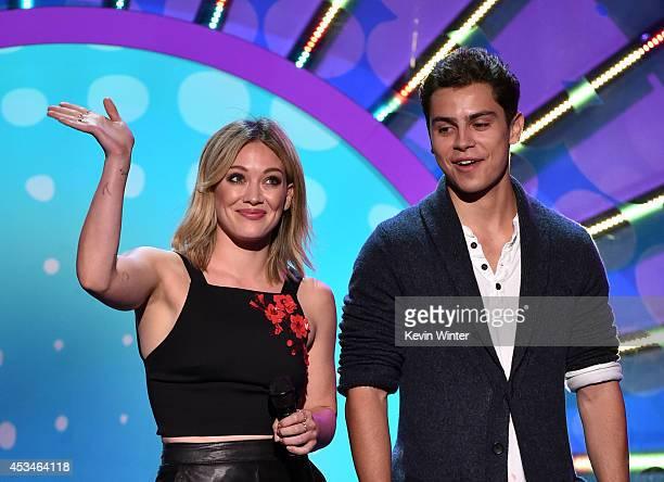Recording artist Hilary Duff and actor Jake T Austin onstage during FOX's 2014 Teen Choice Awards at The Shrine Auditorium on August 10 2014 in Los...
