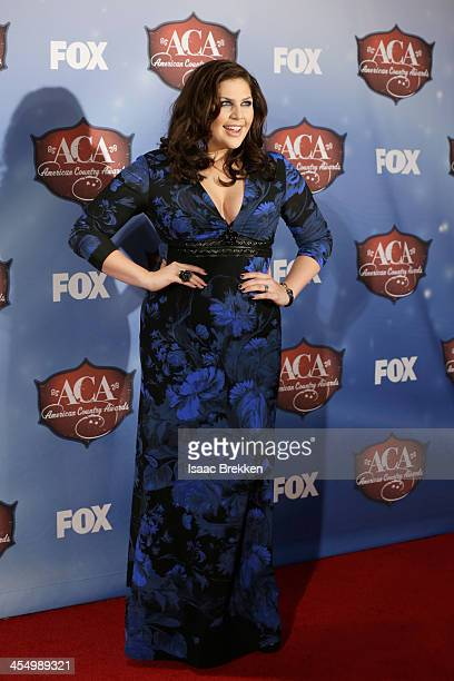 Recording artist Hillary Scott of Lady Antebellum poses in the press room during the American Country Awards 2013 at the Mandalay Bay Events Center...