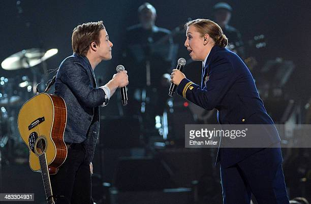 Recording artist Hunter Hayes and Coast Guard Lt jg Katie Spira perform onstage during ACM Presents An AllStar Salute To The Troops at the MGM Grand...