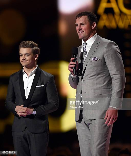 Recording artist Hunter Hayes and Dallas Cowboys tight end Jason Witten speak onstage during the 50th Academy of Country Music Awards at ATT Stadium...
