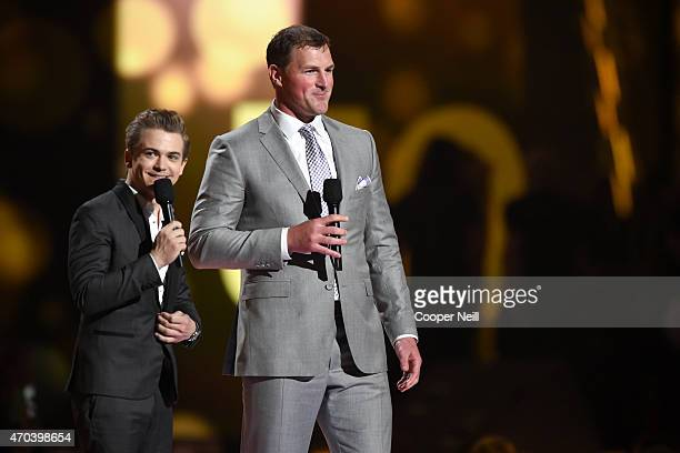 Recording artist Hunter Hayes and NFL player Jason Witten speak onstage during the 50th Academy Of Country Music Awards at ATT Stadium on April 19...