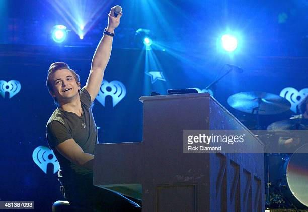 Recording artist Hunter Hayes performs onstage during iHeartRadio Country Festival in Austin at the Frank Erwin Center on March 29 2014 in Austin...