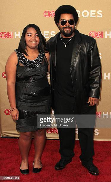 Recording artist Ice Cube and his daughter attend the CNN Heroes: An All-Star Tribute at The Shrine Auditorium on December 11, 2011 in Los Angeles,...