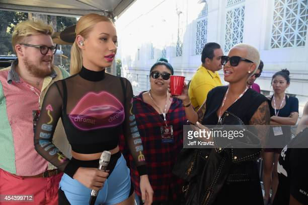 Recording artist Iggy Azalea and model Amber Rose attend day 1 of the 2014 Budweiser Made in America Festival at Los Angeles Grand Park on August 30...