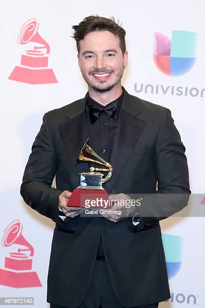 Recording artist J Balvin poses backstage with the award for the Best Urban Song 'Ay Vamos' in the press room during the 16th Latin GRAMMY Awards at...