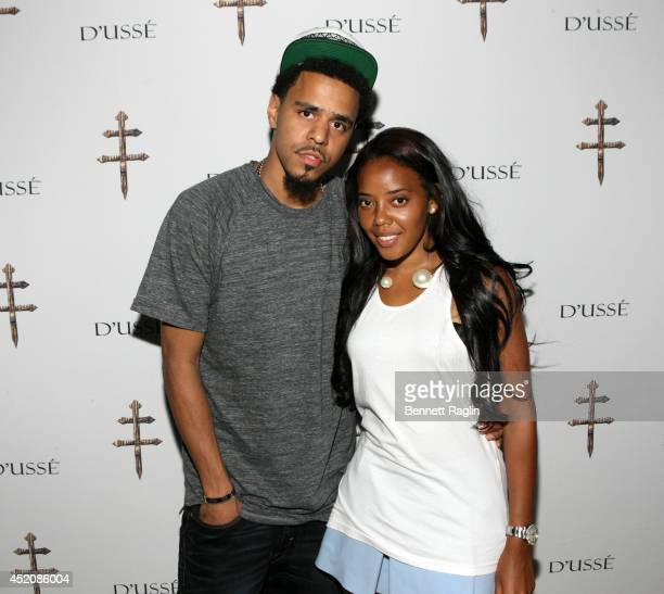 Recording artist J Cole TV personality Angela Simmons attend D'USSE VIP Riser Lounge At On The Run Tour MetLife Stadium on July 12 2014 in East...