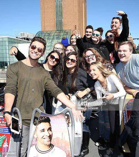 Recording artist Jake Miller poses for a photo with fans at the Jake Miller Ride Of Fame Imminent Induction Ceremony on October 11 2016 in New York...