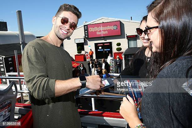 Recording artist Jake Miller signs an autograph at the Jake Miller Ride Of Fame Imminent Induction Ceremony on October 11 2016 in New York City