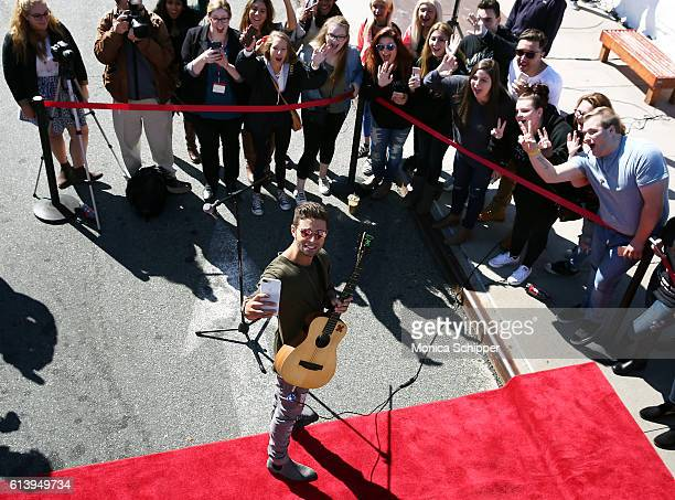 Recording artist Jake Miller takes a selfie with fans at the Jake Miller Ride Of Fame Imminent Induction Ceremony on October 11 2016 in New York City