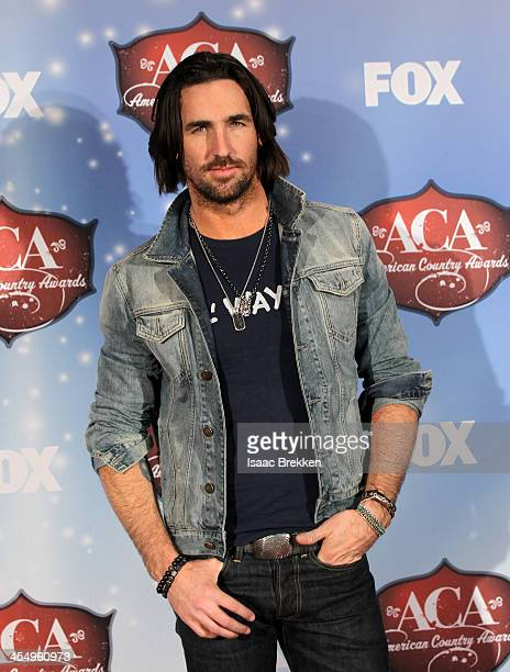 Recording artist Jake Owen poses in the press room during the American Country Awards 2013 at the Mandalay Bay Events Center on December 10 2013 in...
