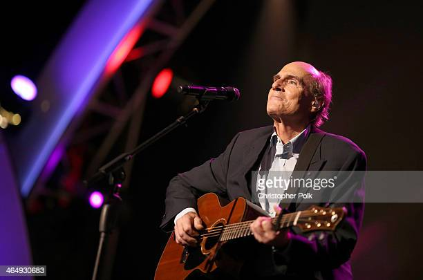 Recording artist James Taylor performs onstage at 2014 MusiCares Person Of The Year Honoring Carole King at Los Angeles Convention Center on January...