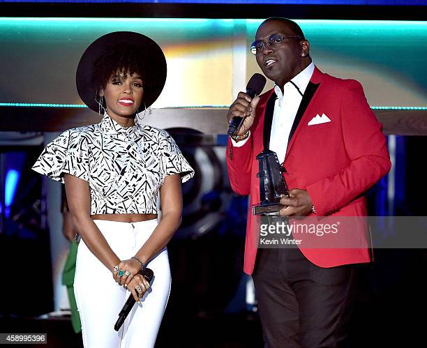Recording artist Janelle Monae accepts the Hollywood Song Award for 'What is Love?' from 'Rio 2' from Randy Jackson onstage during the 18th Annual...