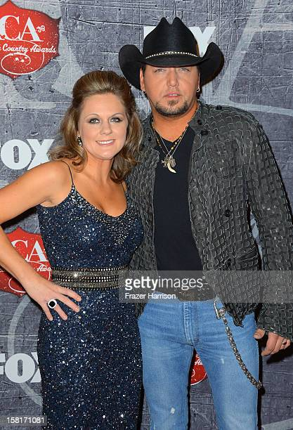 Recording artist Jason Aldean and his wife Jessica Aldean arrive at the 2012 American Country Awards at the Mandalay Bay Events Center on December...