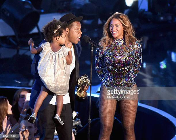Recording artist Jay Z and daughter Blue Ivy Carter present the Michael Jackson Video Vanguard Award to honoree Beyonce onstage during the 2014 MTV...