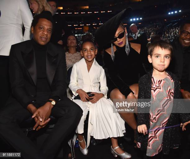 Recording artist Jay Z daughter Blue Ivy Carter recording artist Beyonce and a guest attend the 60th Annual GRAMMY Awards at Madison Square Garden on...