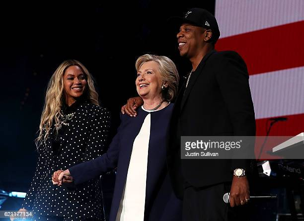 Recording artist Jay Z is seen on a screen as he performs during a Get Out The Vote concert Democratic presidential nominee former Secretary of State...