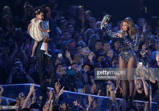 Recording artist JayZ and daughter Blue Ivy Carter present the Michael Jackson Video Vanguard Award to honoree Beyonce on stage at the MTV Video...