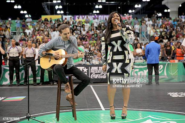 Recording artist Jazmine Sullivan performs the national anthem at the Sprite celebrity basketball game during the 2015 BET Experience at the Los...