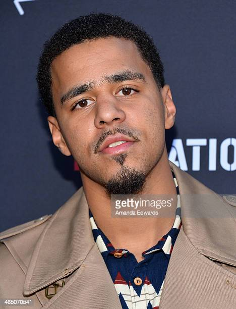 Recording artist JCole arrives at the Roc Nation PreGRAMMY Brunch presented by MAC Viva Glam on January 25 2014 in Los Angeles California