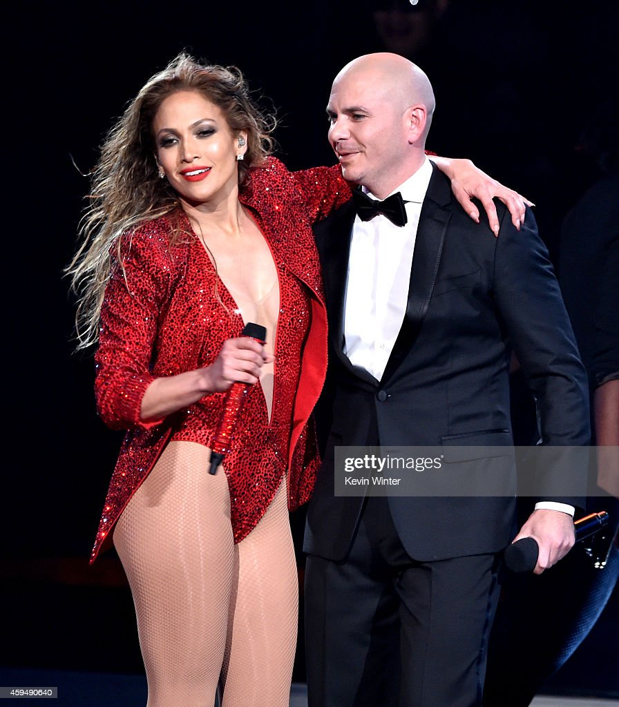 Recording artist Jennifer Lopez (L) and host Pitbull perform onstage at the 2014 American Music Awards at Nokia Theatre L.A. Live on November 23, 2014 in Los Angeles, California.