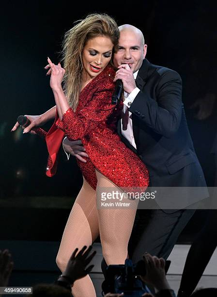 Recording artist Jennifer Lopez and host Pitbull perform onstage at the 2014 American Music Awards at Nokia Theatre LA Live on November 23 2014 in...