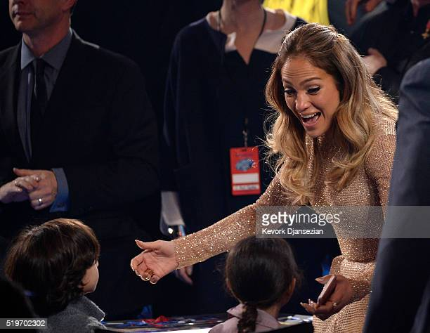 Recording artist Jennifer Lopez greets her children during FOX's 'American Idol' Finale For The Farewell Season at Dolby Theatre on April 7 2016 in...