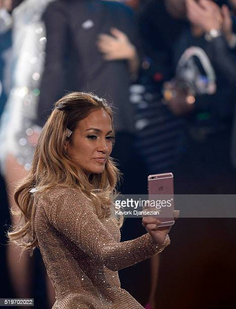 Recording artist Jennifer Lopez poses for a selfie during FOX's 'American Idol' Finale For The Farewell Season at Dolby Theatre on April 7 2016 in...