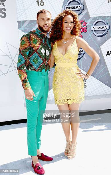 Recording artist Jidenna and basketball analyst Rosalyn GoldOnwude attend the 2016 BET Awards at the Microsoft Theater on June 26 2016 in Los Angeles...