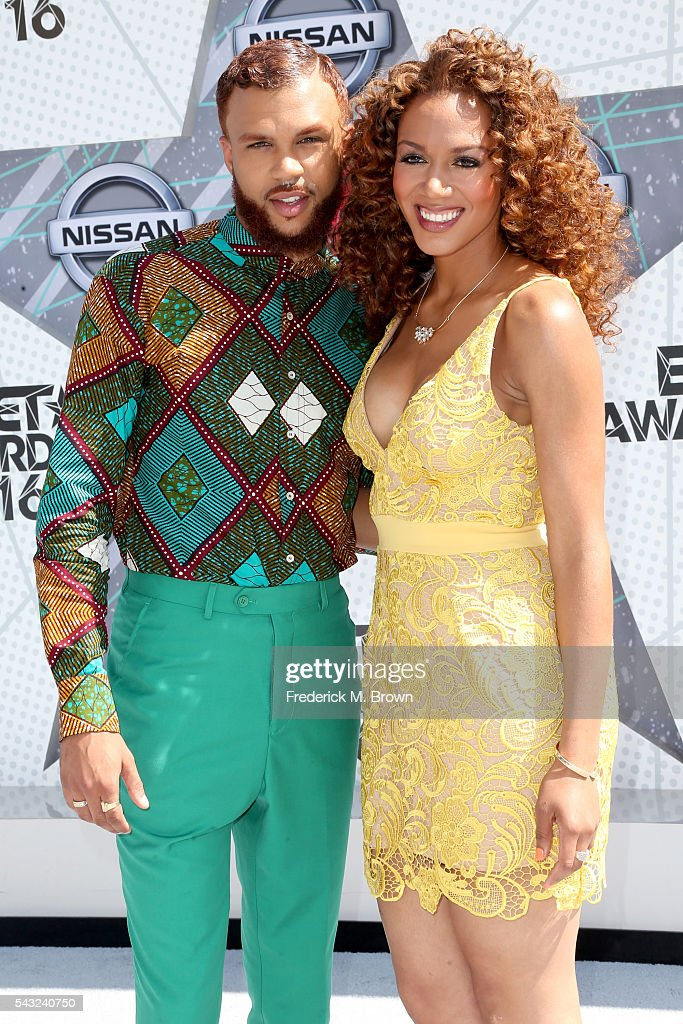 Recording artist Jidenna (L) and basketball analyst Rosalyn Gold-Onwude attend the 2016 BET Awards at the Microsoft Theater on June 26, 2016 in Los Angeles, California.