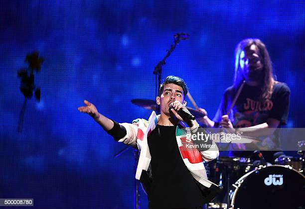 Recording artist Joe Jonas and Jack Lawless of DNCE perform onstage during 102.7 KIIS FM's Jingle Ball 2015 Presented by Capital One at STAPLES...