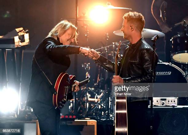 Recording artist Joe Walsh and cohost Dierks Bentley perform onstage during the 52nd Academy of Country Music Awards at TMobile Arena on April 2 2017...