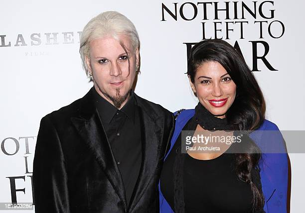 Recording Artist John 5 and Rita Lowery attend the Nothing Left To Fear Los Angeles premiere at ArcLight Cinemas on September 25 2013 in Hollywood...