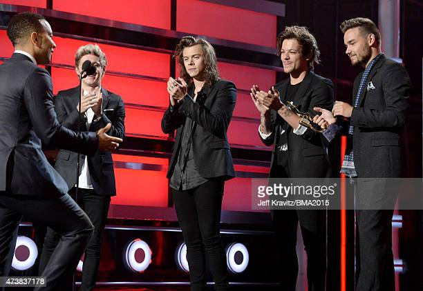 Recording artist John Legend accepts the Top Radio Song award for 'All of Me' from recording artists Niall Horan Harry Styles Louis Tomlinson and...