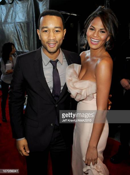 Recording artist John Legend and Christine Teigen arrive at the 2010 American Music Awards at Nokia Theatre L.A. Live on November 21, 2010 in Los...