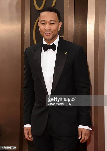 Recording artist John Legend attends the Oscars held at Hollywood Highland Center on March 2 2014 in Hollywood California